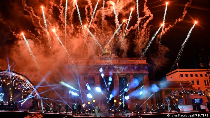 Fireworks light the sky during the New Year celebrations at the Brandenburg Gate in Berlin, Germany