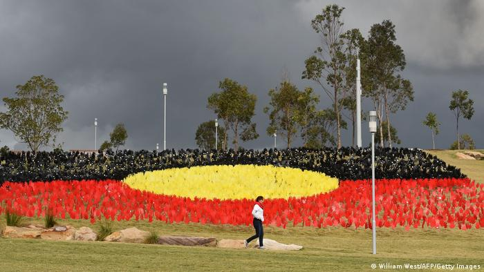 Sea of Hands art installation in Australia showing the Aboriginal red, black and yellow flag