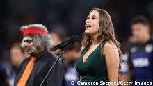 SYDNEY, AUSTRALIA - DECEMBER 05: Olivia Fox sings the national anthem during the 2020 Tri-Nations match between the Australian Wallabies and the Argentina Pumas at Bankwest Stadium on December 05, 2020 in Sydney, Australia. (Photo by Cameron Spencer/Getty Images)
