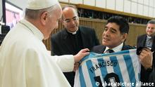 File photo - Diego Maradona gives to Pope Francis a light blue-and-white jersey with his Argentine national team number 10 and the name Francisco on it at the Vatican on September 1, 2014. Pope Francis attends a special audience for players and organisers of a charity soccer match that was being played in Rome to promote peace and inter-religious cooperation. Pope Francis read an address to the participants in the Vatican's large audience hall and then each of them filed past the pontiff to greet and have their picture taken with him. Maradona chatted with his compatriot longer than most of the others. The charity match, which was based on a suggestion by the pope, includes active and retired players of various religions. Besides Maradona, participants at the audience in the Vatican included Italy Gianluigi Buffon , Andrea Pirlo, Roberto Baggio , Alessandro del Piero , french David Trezeguet and Argentina Javier Zanetti. Diego Maradona has died from a heart attack just days after turning 60. The Argentinian football legend died at home, his lawyer said, just two weeks after having surgery on a blot clot in his brain. Widely regarded as one of the greatest players of all time on the pitch, his life off the pitch was equally notorious - amid battles with drug and alcohol addiction. Photo by ABACAPRESS.COM