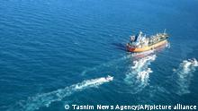 """In this photo released Monday, Jan. 4, 2021, by Tasnim News Agency, the MT Hankuk Chemi, a South Korean-flagged tanker is escorted by Iranian Revolutionary Guard boats on the Persian Gulf. Iranian state television acknowledged that Tehran seized the oil tanker in the Strait of Hormuz. The report on Monday alleged the MT Hankuk Chemi had been stopped by Iranian authorities over alleged """"oil pollution"""" in the Persian Gulf and the strait. (Tasnim News Agency via AP)"""