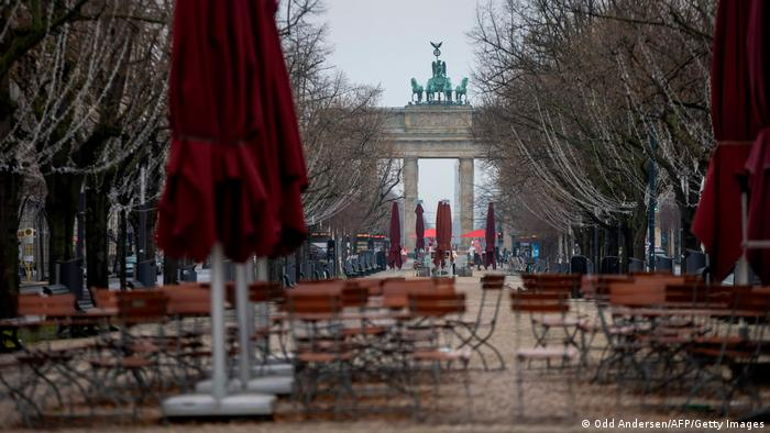 Abandoned cafe chairs and tables are seen on the deserted Unter den Linden boulevard in Berlin