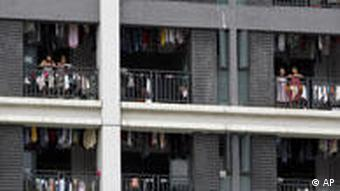 Foxconn workers standing on their balconies in an apartment block