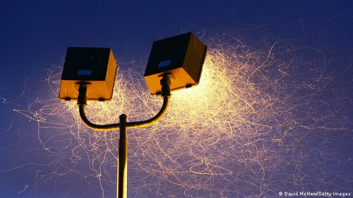 Insects swarming around a streetlight