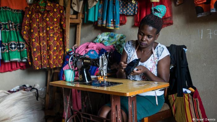 A woman uses a sewing machine to make a corona protective mask in Mpigi, Uganda