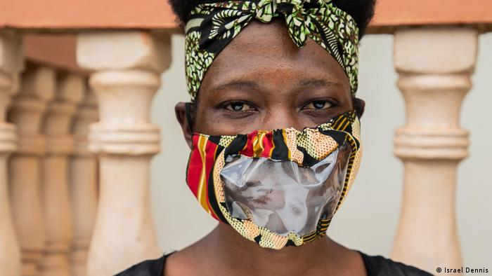 Hearing-impaired garmet maker Agnes Nabgala wears one of Kimuli Fashionability's COVID masks fitted with a recycled plastic panel to allow for lip-leading