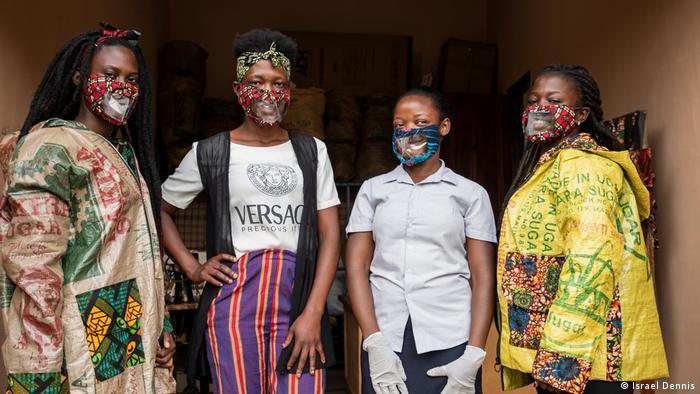 Kimuli Fashionability employees present the corona masks for lip reading in Mpigi, Uganda
