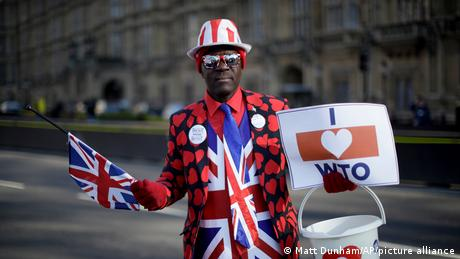 A Brexit supporter dressed in the colors of the Union Jack