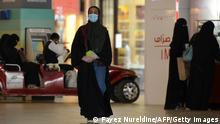 Women shopping at a mall in the Saudi capital Riyadh, wear face masks on June 4, 2020, after the authorities eased some of the restrictive measures put in place to combat the spread of the novel coronavirus, but at the same time imposed tough penalties against those not wearing protective face masks in public places. (Photo by FAYEZ NURELDINE / AFP) (Photo by FAYEZ NURELDINE/AFP via Getty Images)