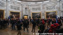 Supporters of US President Donald Trump enter the US Capitol's Rotunda on January 6, 2021, in Washington, DC. - Demonstrators breeched security and entered the Capitol as Congress debated the a 2020 presidential election Electoral Vote Certification. (Photo by Saul LOEB / AFP) (Photo by SAUL LOEB/AFP via Getty Images)