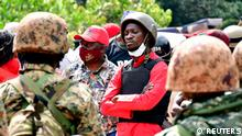 Ugandan presidential candidate Bobi Wine surrounded by supporters and security officials