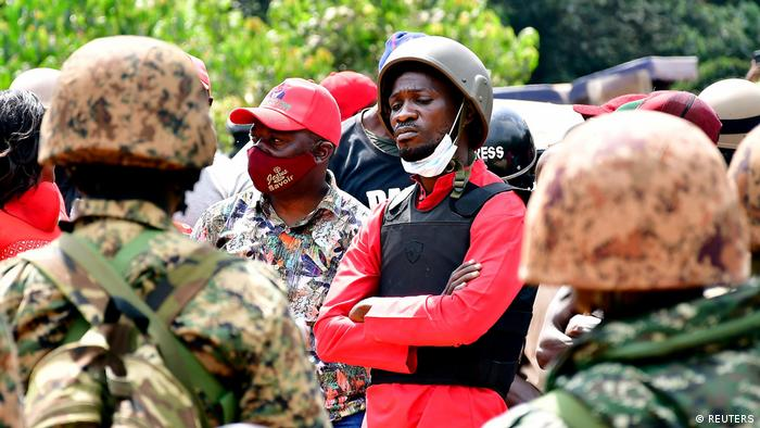 Ugandan opposition candidate Bobi Wine surrounded by soldiers