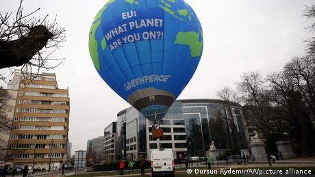 An environmental activist group places a hot-air balloon in front of the EU council building ahead of an EU summit on climate, 2020.