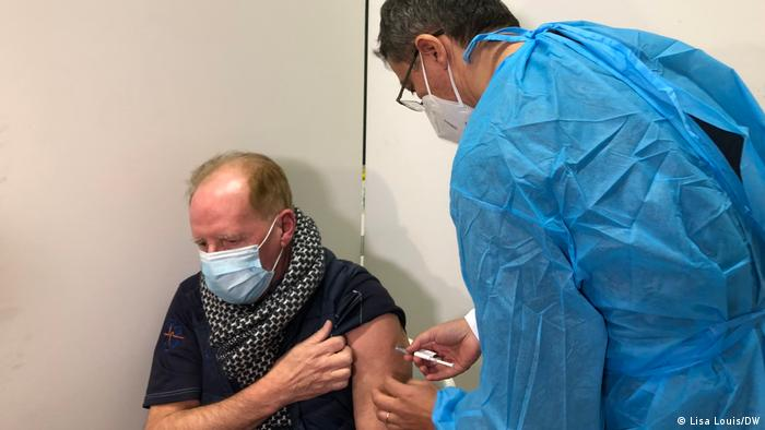 Man being vaccinated by Christian Lehmann