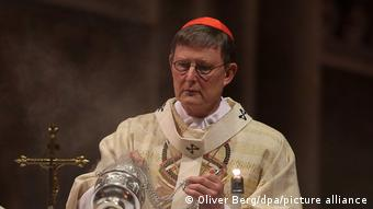 Woelki in robes celebrating Chrismas Eve in Cologne's Dom cathedral