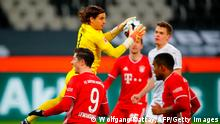 Moenchengladbach's Swiss goalkeeper Yann Sommer catches the ball over Bayern Munich's Polish forward Robert Lewandowski (L) during the German first division Bundesliga football match Borussia Moenchengladbach v FC Bayern Munich in Moenchengladbach, western Germany on January 8, 2021. (Photo by WOLFGANG RATTAY / POOL / AFP) / DFL REGULATIONS PROHIBIT ANY USE OF PHOTOGRAPHS AS IMAGE SEQUENCES AND/OR QUASI-VIDEO (Photo by WOLFGANG RATTAY/POOL/AFP via Getty Images)
