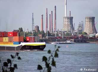 Rhine river with a cargo ship and heavy industry in the background