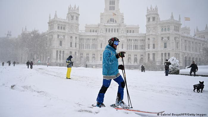 A man skis in Cibeles square amid a heavy snowfall in Madrid