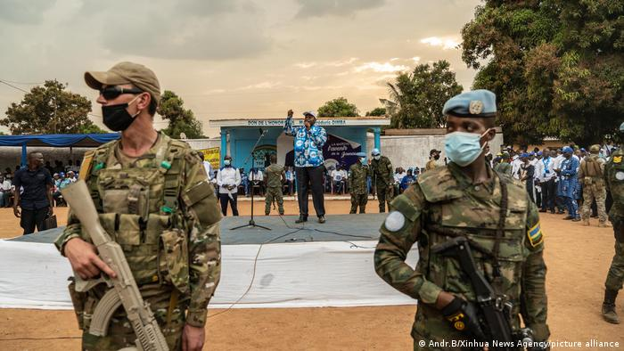 UN peacekeepers stand guard as President Faustin-Archange Touadera of Central African Republic speaks in the background.