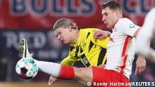 Soccer Football - Bundesliga - RB Leipzig v Borussia Dortmund - Red Bull Arena, Leipzig, Germany - January 9, 2021 Borussia Dortmund's Erling Braut Haaland in action with RB Leipzig's Willi Orban Pool via REUTERS/Ronny Hartmann DFL regulations prohibit any use of photographs as image sequences and/or quasi-video.