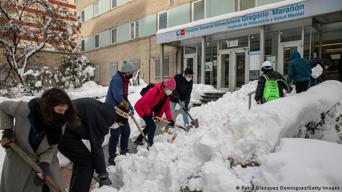 Volunteers clearing snow