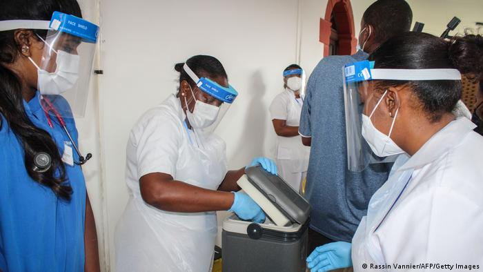Medical workers unpacking COVID-19 vaccines