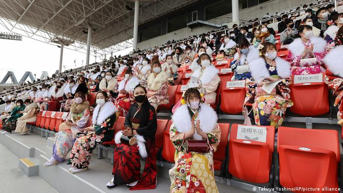 New adults clad in Furisode (long sleeves Japanese garment for young women) attend a Coming-of-Age ceremony at Hanazono Rugby Stadium in Higashiosaka City, Osaka Prefecture on January 11, 2021.