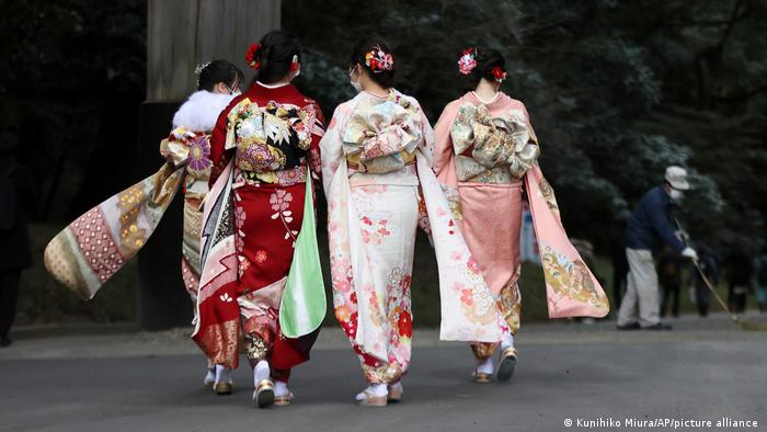 Women wear colourful traditional costumes