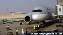 Saudi airport officials surround the first Qatar Airways plane in three years to land in Riyadh