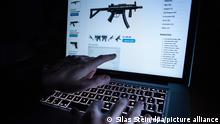 ILLUSTRATION - A man points to the webpage of an online shop that sells machine guns on the Darknet in Rottweil,Germany, 12 November 2016. Photo:Silas Stein/dpa
