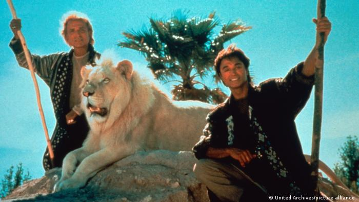 Siegfried and Roy with a white lion