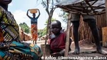 In this photo taken Thursday, Sept. 6, 2018, people live in an internally displaced persons camp next to St. Charles Lwanga Church in Seko, Central African Republic. Children are bearing the brunt of five years of fighting in Central African Republic, according to a new report by the United Nations children's agency released Friday, Nov. 30, 2018. (Ashley Gilbertson/UNICEF via AP)