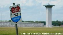 A no trespassing sign is displayed outside the federal prison complex in Terre Haute, Ind., Friday, Aug. 28, 2020. The scheduled federal execution at the facility of Keith Nelson, who was convicted in the killing of a 10-year-old Kansas girl, was back on track Friday after an appellate panel tossed a lower court's ruling that would have required the government to get a drug prescription before it could use pentobarbital to kill the inmate. (AP Photo/Michael Conroy)