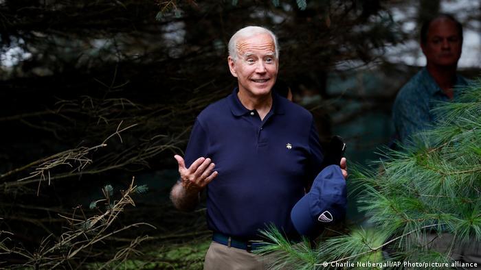 Joe Biden standing in the forest