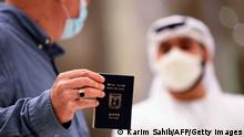 A man holding a passport