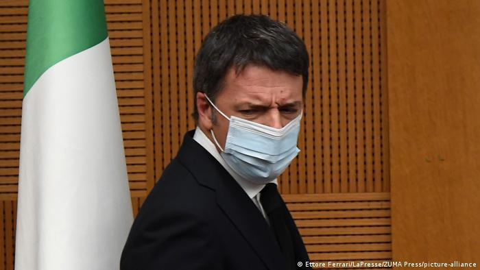 Matteo Renzi pictured with a face mask during a press conference on Wednesday