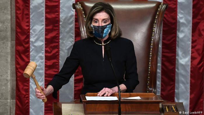 Democrat House speaker Nancy Pelosi bangs the gavel