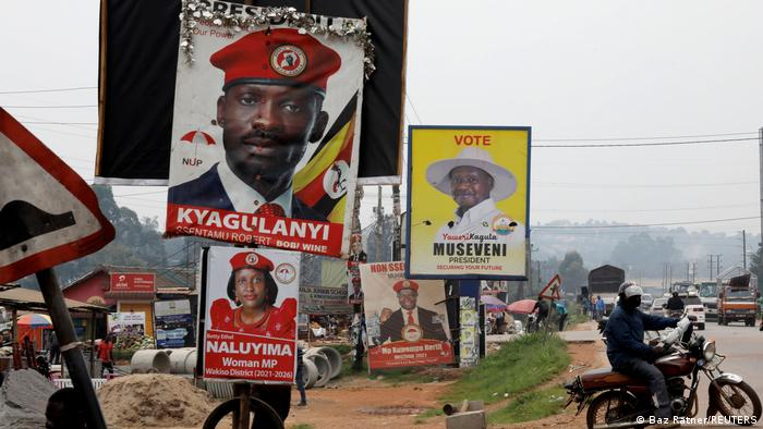 Elections billboards for Uganda's President Yoweri Museveni, and opposition leader and presidential candidate Robert Kyagulanyi, also known as Bobi Wine, are seen on a street in Kampala, Uganda