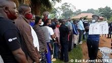 Voters waiting in a queue at a polling station in Kampala