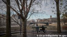 PARIS, FRANCE - JANUARY 01: Parisians sit on the banks of the river Seine on Ile Saint-Louis on the first day of 2021 on January 01, 2021 in Paris, France. New Year's eve celebrations and fireworks were cancelled throughout France to curb the spread of Covid-19 infections as France continues the process of trying to ease restrictions after two lockdowns. Cultural and Leisure venues remain shut as daily infection rates still not meeting the target set by the government. (Photo by Kiran Ridley/Getty Images)