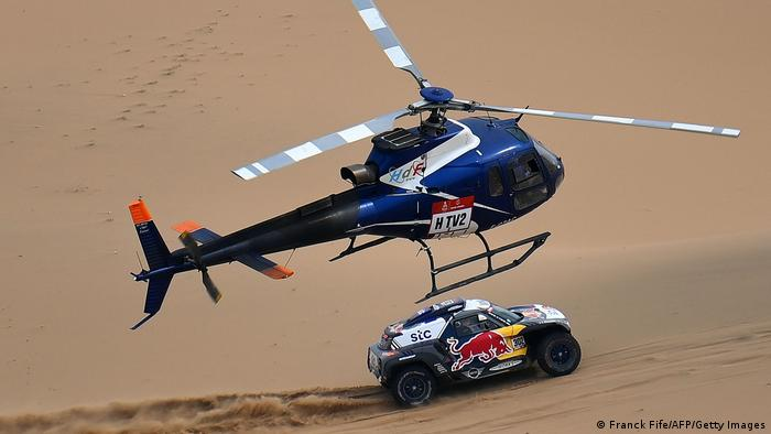 Mini's driver Stephane Peterhansel and his co-driver Edouard Boulanger of France compete in the 2021 Dakar Rally.