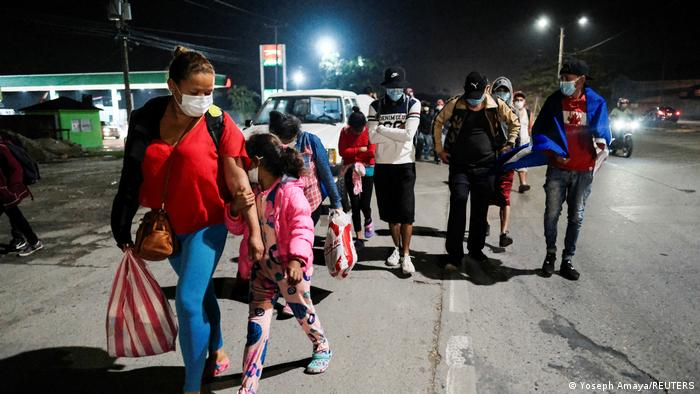 Hondurans take part in a new caravan of migrants, set to head to the United States