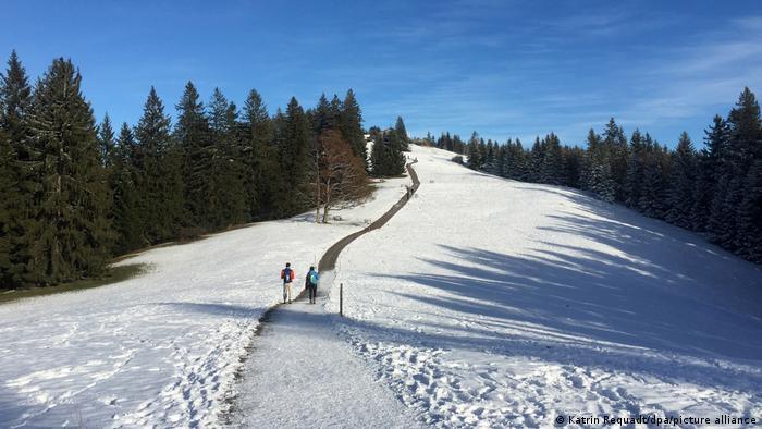 Hikers in a snowy German landscape