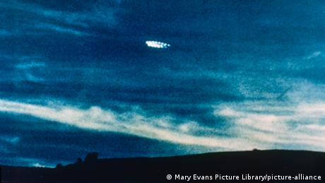 A flying object looking like a ring of lights in the night sky