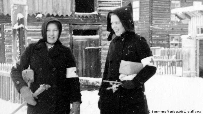 Two women wearing Red Cross armbands in 1941