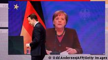 Merkel gives her speech from the Chancellery