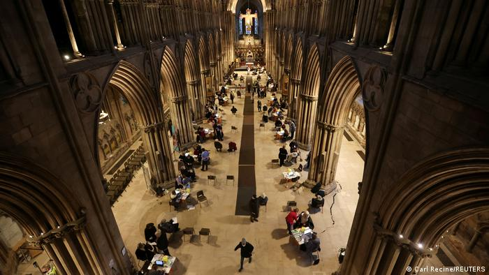 People receive COVID-19 vaccines inside Lichfield Cathedral