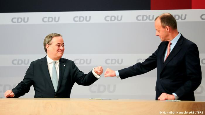 Laschet and Merz doing a fist-bump