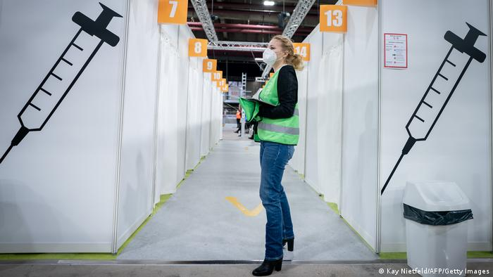 A woman waits inside a vaccination center in Berlin