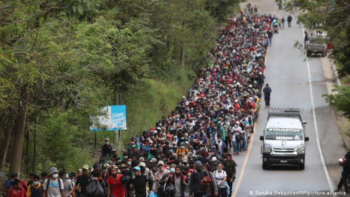 Migrants hoping to reach the U.S. border walk alongside a highway in Chiquimula, Guatemala
